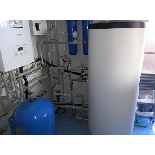 Система горячего водоснабжения и отопления с использованием вакуумных коллекторов