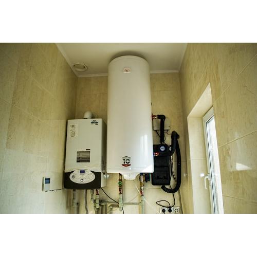 Система горячего водоснабжения и отопления на вакуумных коллекторах